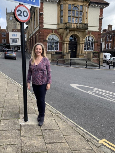 Jane Davies by 20mph sign and Marlborough Town Hall
