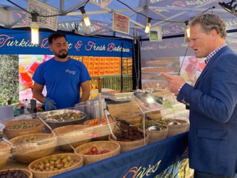 Simon Jacobs choosing olives from market stall